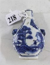 A CHINESE CERAMIC BLUE AND WHITE SNUFF BOTTLE, landscape and fishing scene, with Foo dog handles. (no stopper). Height 8cm