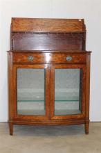 A GEORGE III SATINWOOD DISPLAY CABINET, shell medallion inlay, bow fronted, enamel handles. Width 82cm. Height 120cm.