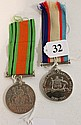 AN AUSTRALIAN SERVICE MEDAL AND DEFENCE MEDAL.