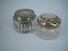 TWO SMALL GLASS JARS, one with silver cover; London. (2)