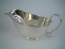 A SILVER SAUCEBOAT with applied rim and oval foot; Joseph Rodgers, Sheffield 1934. Weight approx 120g.
