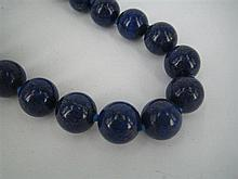 A LAPIS LAZULI BEAD NECKLACE, 13mm beads strung and knotted with magnetic sphere clasp.