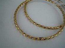 *A PAIR OF 18ct GOLD ROPE-TWIST BANGLES. Total weight 14.8g.