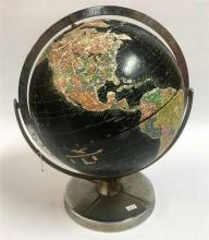 A VINTAGE WORLD GLOBE, excel turning and on chrome base. Circa 1970. Height 44cm.