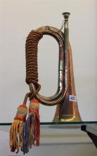 A BRASS AND COPPER BUGLE. Height 31cm