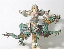 A MING GLAZED TERRACOTTA SCULPTURAL TILE FROM A TEMPLE, warrior riding a dragon. ht. 30cm.