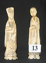A PAIR OF CHINESE  MARINE IVORY CARVED FIGURES, one with repair to head. ht. 11cm.