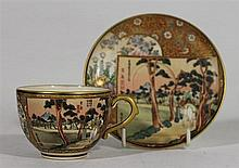 A JAPANESE SATSUMA TEACUP AND SAUCER, with landscape and floral decoration, signed. Saucer diameter 12.5cm.