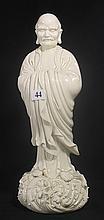 A BLANC DE CHINE SCULPTURE OF A DARUMA. ht. 34cm.