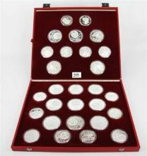 A ''1980 MOSCOW OLYMPIC GAMES'' SILVER SOIN SET, each coin themed with a sport and a city, fourteen 5 Rouble coins, forteen 10 Rouble..