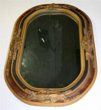 AN OVAL GILT FRAMED WALL MIRROR. 38 x 56cm.