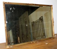 A VINTAGE GILT FRAMED MIRROR. 55 x 80cm. (a/f)