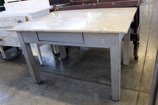 A Marble Top Work Table With