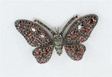 A LARGE GARNET AND SILVER BUTTERFLY BROOCH, butterfly encrusted with garnets and marcasites.