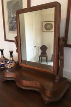 A VICTORIAN MAHOGANY TOILET MIRROR with serpentine plateau base. Ht 60cm. Width 56cm.