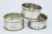 THREE STERLING SILVER NAPKIN RINGS, various design. Indistinct marks. Total weight 47.4g.