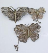 THREE FILIGREE BROOCHES, shaped as butterflies. Total weight 33.2g. Length 6.5, 5.7 and 4cm.