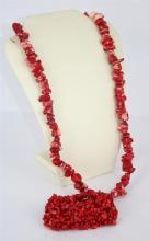 A DYED CORAL NECKLACE, rough shape, together with a bracelet. (2)