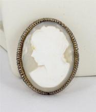 A SHELL CAMEO BROOCH, set in 9 carat yellow gold (tested). Length 4.4cm. (hair line in cameo)