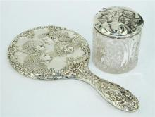 A STERLING SILVER HAND MIRROR, with angle design, Broadway and Co, Birmingham 1988. Together with a glass body jar with sterling sil...