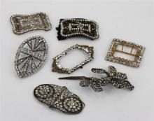 A GROUP OF SEVEN VICTORIAN PASTE BUCKLES, six buckles and one floral decorative piece (to be pinned to garment).