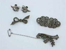 THREE MARCASITE BROOCHES, including one interchangeable into clip earrings. Together with a pair of screw earrings. All on silver. T...