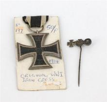 A WWI IRON CROSS MEDAL, Imperial Germany: WWI Iron Cross 2nd Class, 1914 - 1918. Military medal for war merit. Together with a tie p...