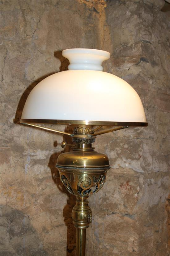 A brass floor lamp raised on tripod feet with milk glass s for Milan floor lamp antique brass 165cm