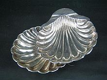 A PAIR OF VICTORIAN SILVER BUTTER SHELLS; Martin, Hall & Co., Sheffield 1893.