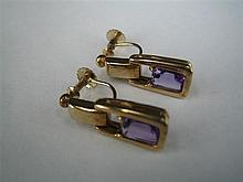 *A PAIR OF AMETHYST AND 9ct GOLD EARRINGS; screw fittings. Total weight 4.9g.