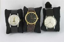 *A GROUP OF THREE GENTS WRISTWATCHES, a Zodiac (missing back), a brass plated Doxa (not in working order) and a stainless steel and...