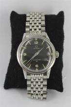 *AN OMEGA 'SEAMASTER 30' GENTS WRISTWATCH, stainless steel case, 34mm diameter, black face, wind-up mechanism.