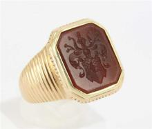 A GENTS SIGNET RING, carved Carnelian seal; 14ct gold. Ring size S. Weight 12.8g.