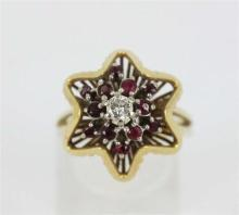 A RETRO RUBY AND DIAMOND STARBURST RING, open pierced wire mount, starburst design set with rubies and a central round brilliant cut...