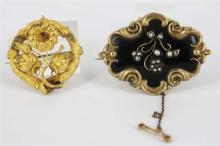 TWO VICTORIAN GOLD FILLED BROOCHES, one a mourning brooch with woven hair to verso and a black enamel and glass pearl front, the oth...