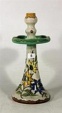 A GOUDA CANDLESTICK, with floral decoration. Height 31cm.