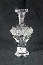 A LALIQUE PERFUME BOTTLE, with rose design. Height 14.6cm.