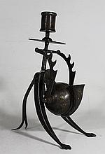 AN INDO-PERSIAN TRAVELLING CANDLESTICK, with integral inkwell and pen rest. Steel with silver and gold Koftgari inlay. ht 21.5cm.