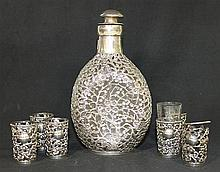 A CHINESE SILVER OVERLAYED DECANTER , and six licquor glasses (af). Decanter ht 18cm.