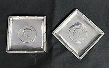 A PAIR OF CHINESE SILVER PIN DISHES, each inset with Sun Yat-sen 'Junk' one dollar coins.