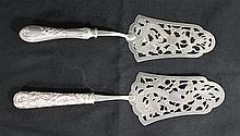 TWO CHINESE SILVER CAKE TROWLES, with pierced blades. lt 28cm.