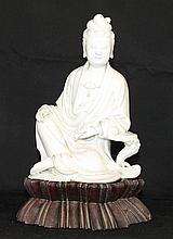 A CHINESE 'BLANC DE CHINE' FIGURE OF GUAN YIN, on wooden base. Figure height  22 cm.