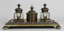 A NINETEENTH CENTURY BRONZE DESK STANDISH, with two ink wells and  filigree border. 23.6 x 13cm