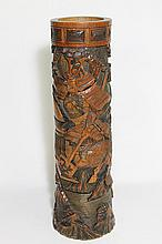 A JAPANESE CARVED BAMBOO VASE, depictng mounted Samurai. ht 46cm.
