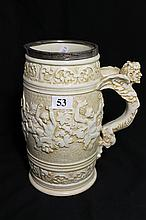 A DOULTON LAMBETH WINE JUG, with Bacchanalian frieze and silver rim, ht 20.5cm.