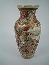 A NAGASAKI POTTERY BALUSTER VASE, painted figures and heightened in gilt. Height 22cm.