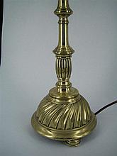 A BRASS TABLE LAMP, spun brass with twist-fluted base. Height 38cm.