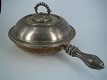 A SILVER-PLATE CHAFING DISH, circular with division, insulated base, screw handle; James Dixon. Diameter 26cm.