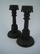 A PAIR OF 19th CENTURY IRISH CARVED BOG-OAK CANDLESTICKS, with shamrock bands. Height 21cm.