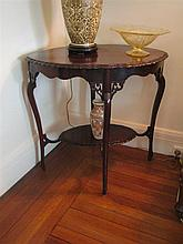 AN EDWARDIAN MAHOGANY LAMP TABLE, shaped rectangular witgh carved apron and with under-platform. Length 76cm.